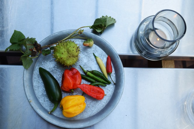 A colorful plate of chilies nicely presented with hygge candle
