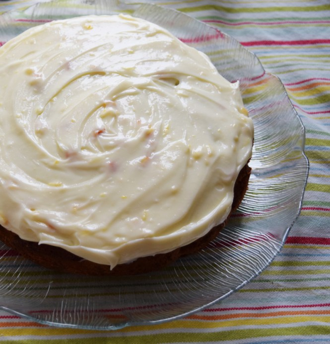 Cover Orange, carrot, and pecan cake with the icing