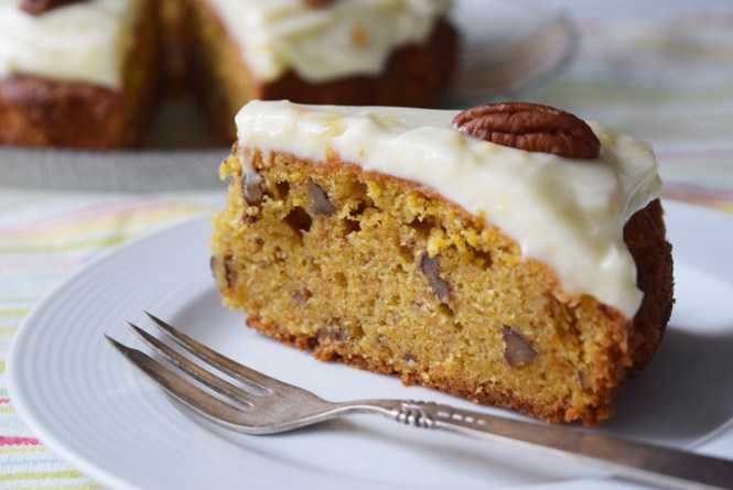 Slice of orange, carrot, and pecan cake