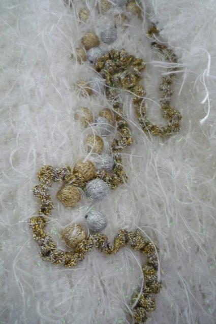 Détail de la veste blanche