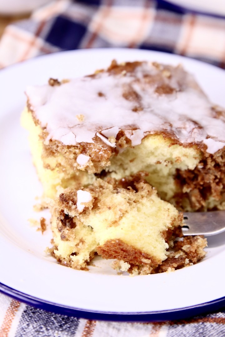 cinnamon coffee cake slice with a bite on fork