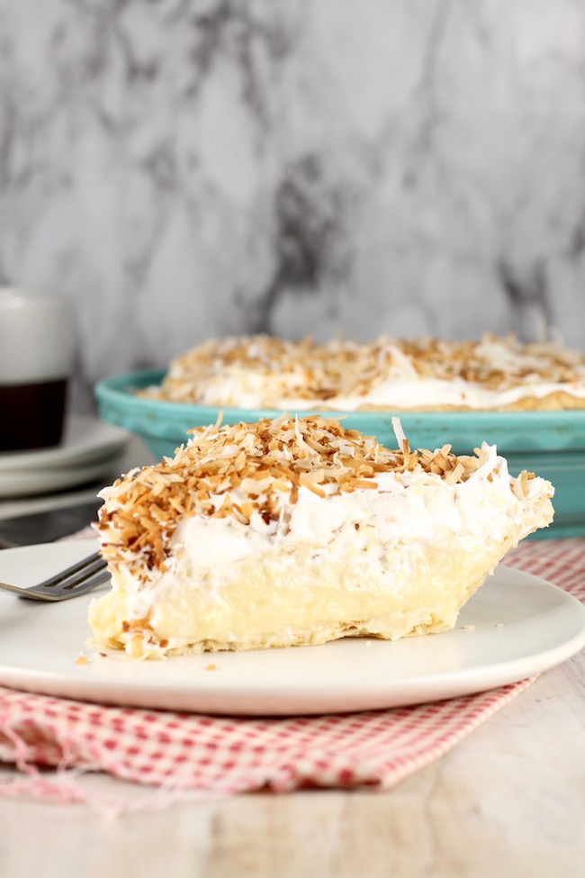 Coconut Cream Pie topped with whipped topping and toasted coconut