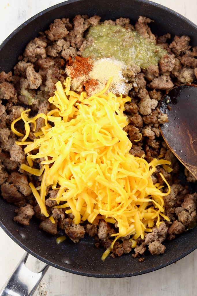 Skillet with ground beef, cheese, salsa and spices