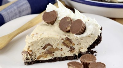 Peanut Butter Pie slice on a plate with Reese's Mini peanut butter cups