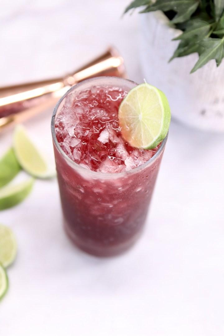 Pomegranate Margarita with lime wheel garnish