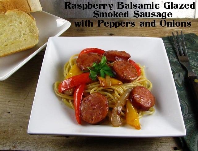 Raspberry Balsamic Glazed Smoked Sausage with Peppers & Onions   www.missinthektichen.com