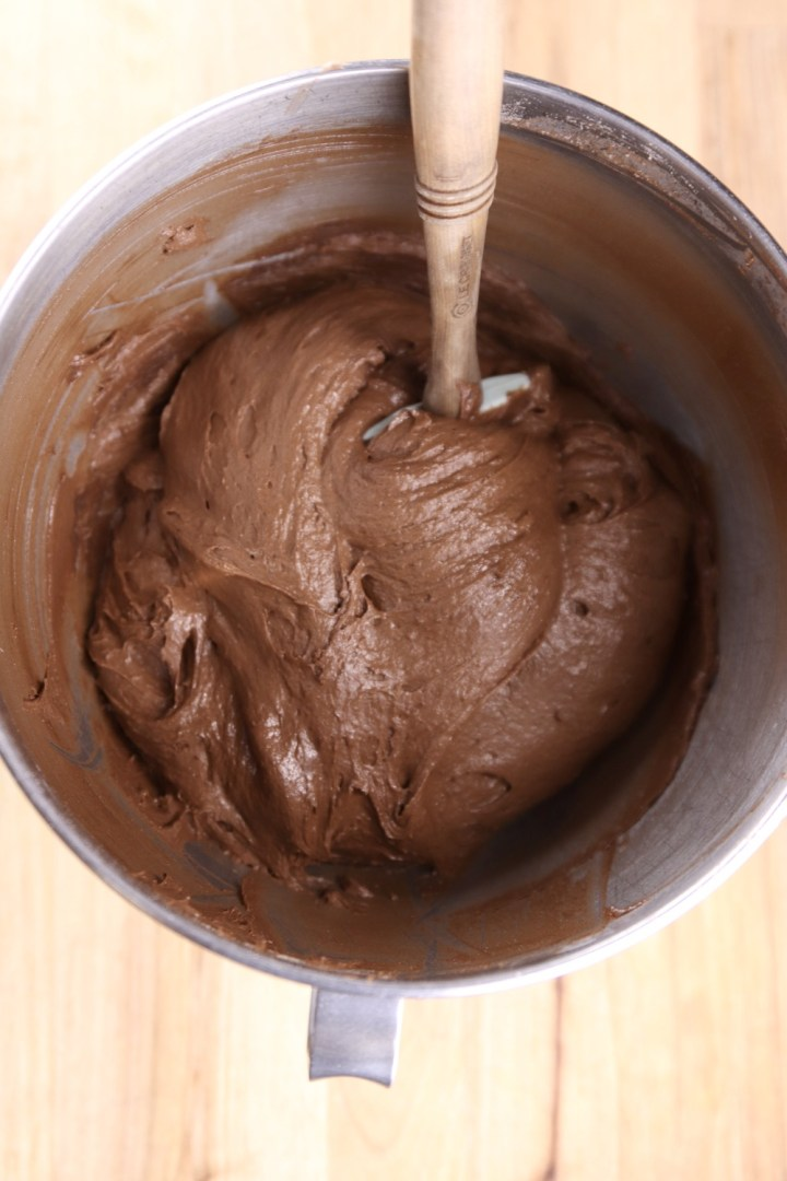 chocolate cake batter in a mixer bowl with spatula