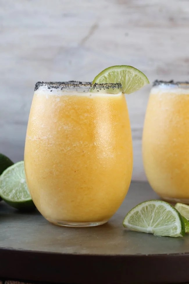 Frozen Peach Margaritas with limes