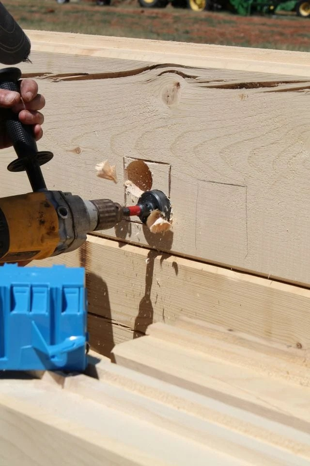 Electric Boxes drilling with forstner bit for log cabin missinthekitchen #LogCabinSaturday