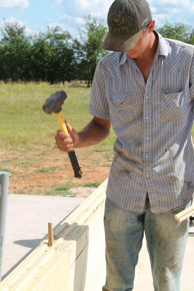 Hammering Dowel Rods into Joints for log cabin  missinthekitchen #LogCabinSaturday
