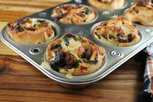 Zesty Sausage and Spinach Ranch Rolls baked in a muffin tin ~ missinthekitchen.com