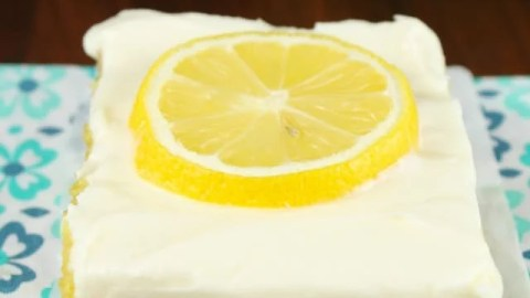 Lemon Bars with Cream Cheese Icing is a delicious dessert recipe for any party or family get together. From MissintheKitchen.com