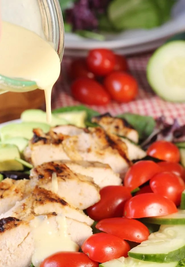 Pouring-Creamy-Citrus-Dressing-Over-Grilled-Chicken-salad