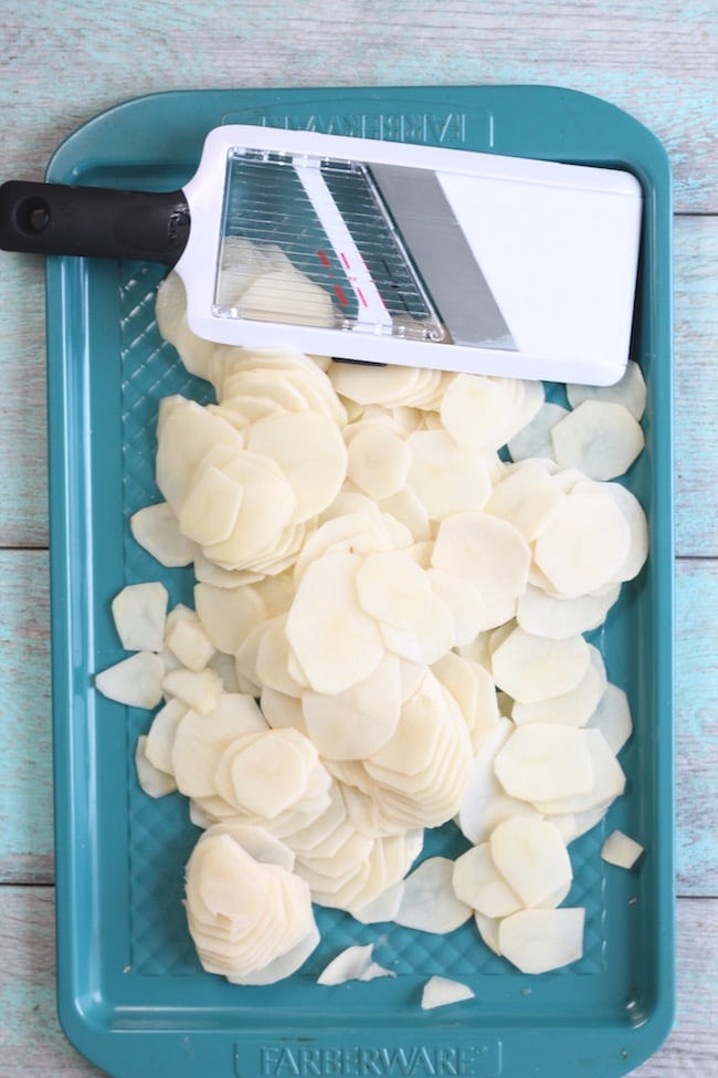 Mandoline and sliced potatoes for Ham Potato Casserole