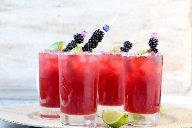 Easy Blackberry Margaritas garnished with blackberries and limes