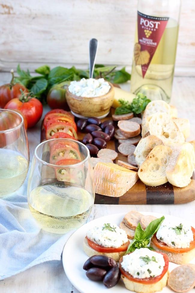 Charcuterie & Fresh Tomato and Herbed Ricotta Bruschetta with wine