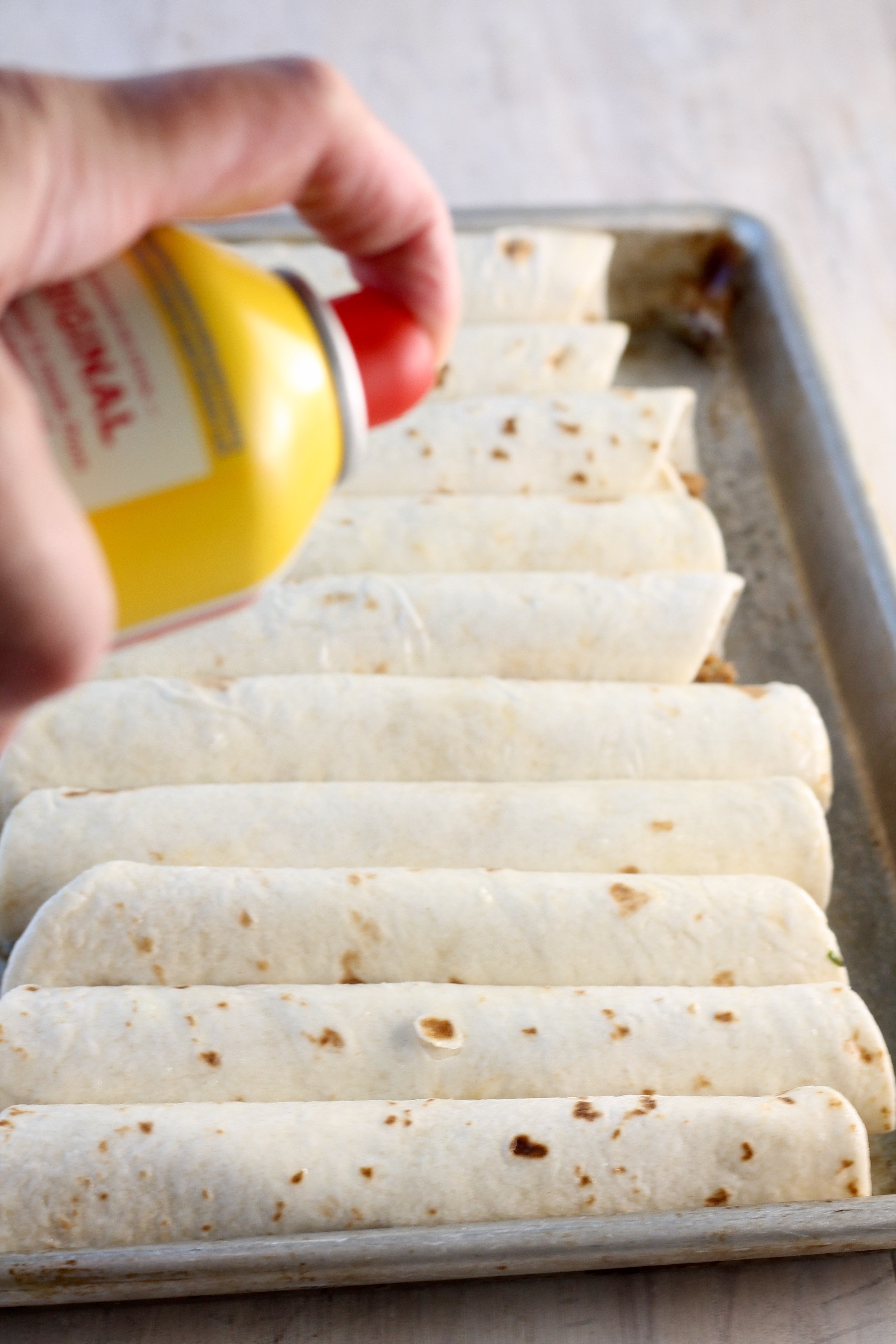 Spray brisket taquitos with non stick cooking spray to help them brown