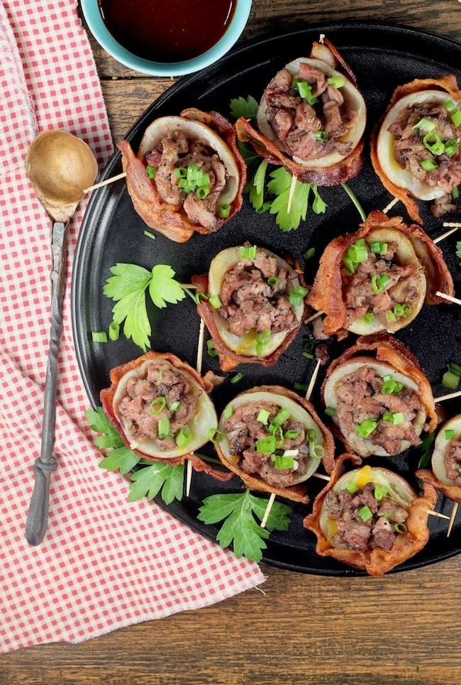 Loaded Potato Skins wrapped in bacon and stuffed with cheese and smoked roast beef