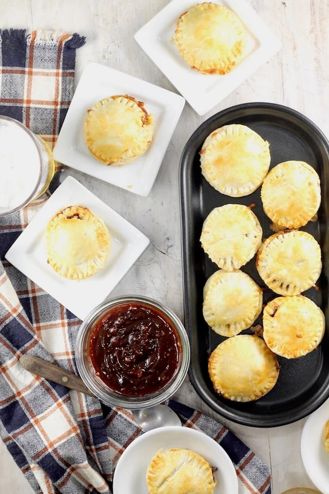 Mini Barbecue Meat Pies dipped in homemade barbecue sauce