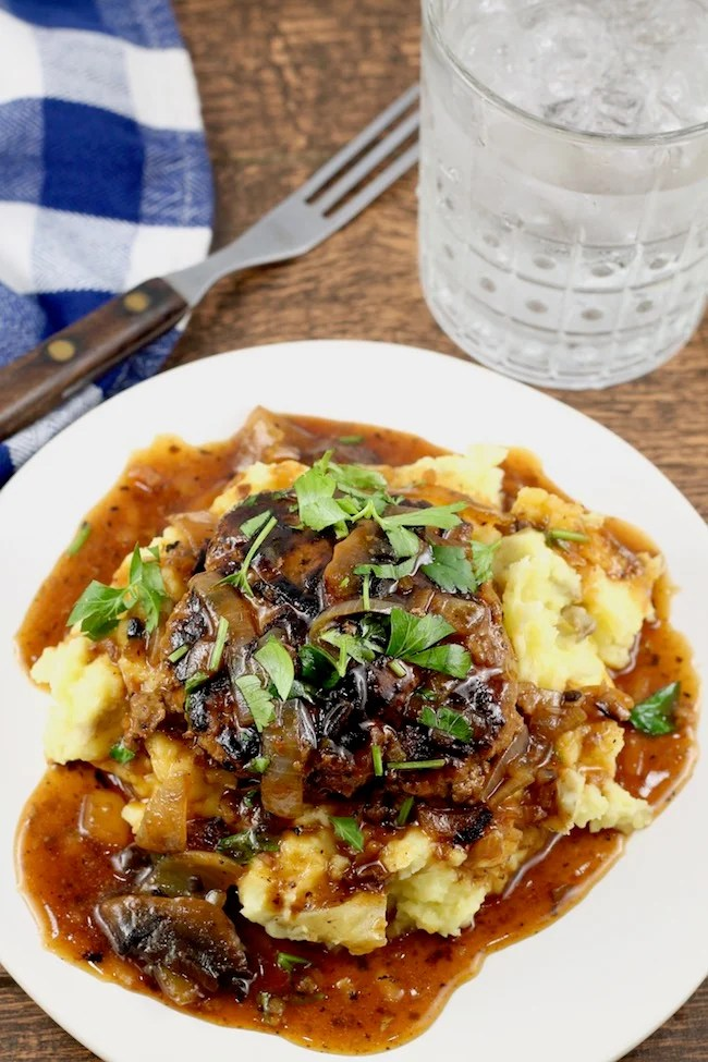 Easy Homemade Salisbury Steak Recipe with Mushroom and Onion Gravy ~ A hearty meal served over mashed potatoes.