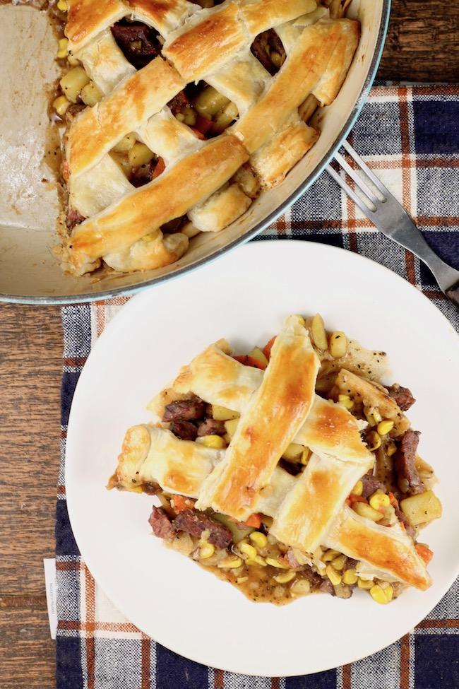 Venison Steak Pot Pie with potatoes, carrots, corn and a lattice puff pastry crust.
