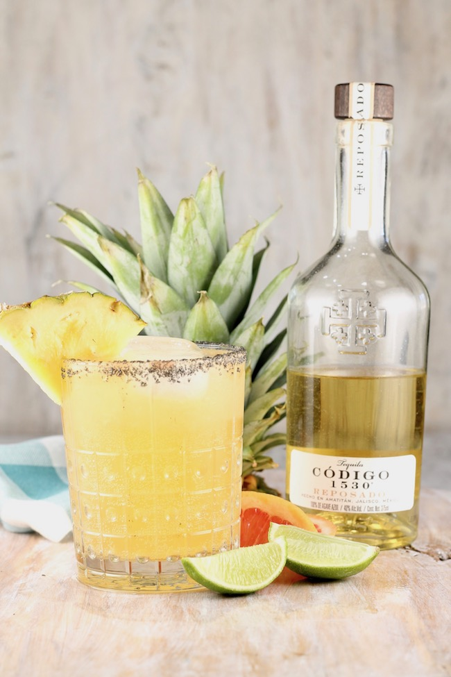 Codigo 1530 Reposado Tequila Pineapple Palmoa Cocktail garnished with fresh pineapple