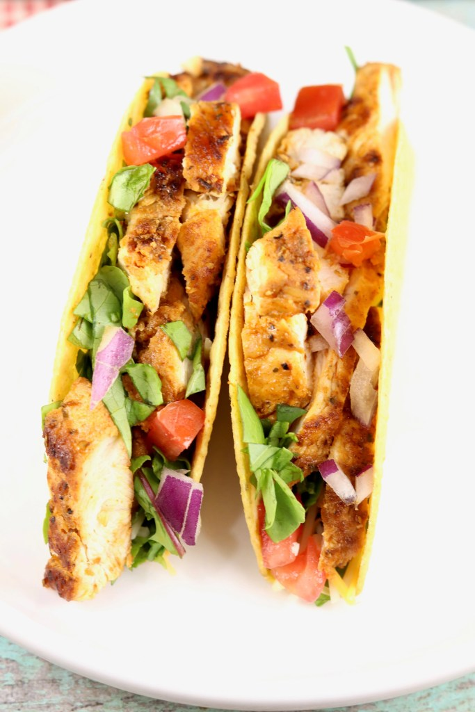 Blackened Chicken Tacos with tomatoes, lettuce and red onion