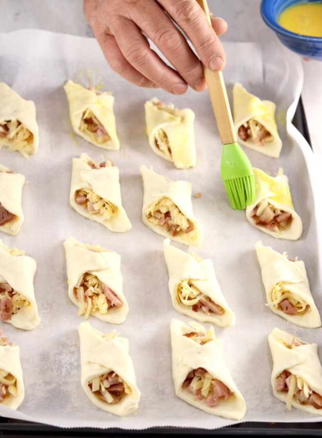 Brushing Puff Pastry Appetizers with egg before baking