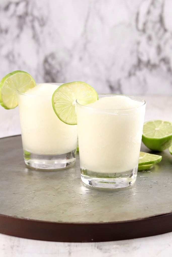 Frozen cocktail with fresh lime garnish