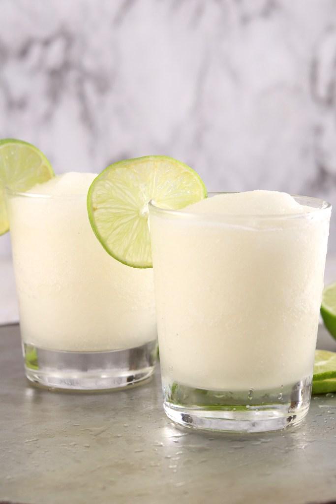 Frozen rum cocktail with fresh lime garnish