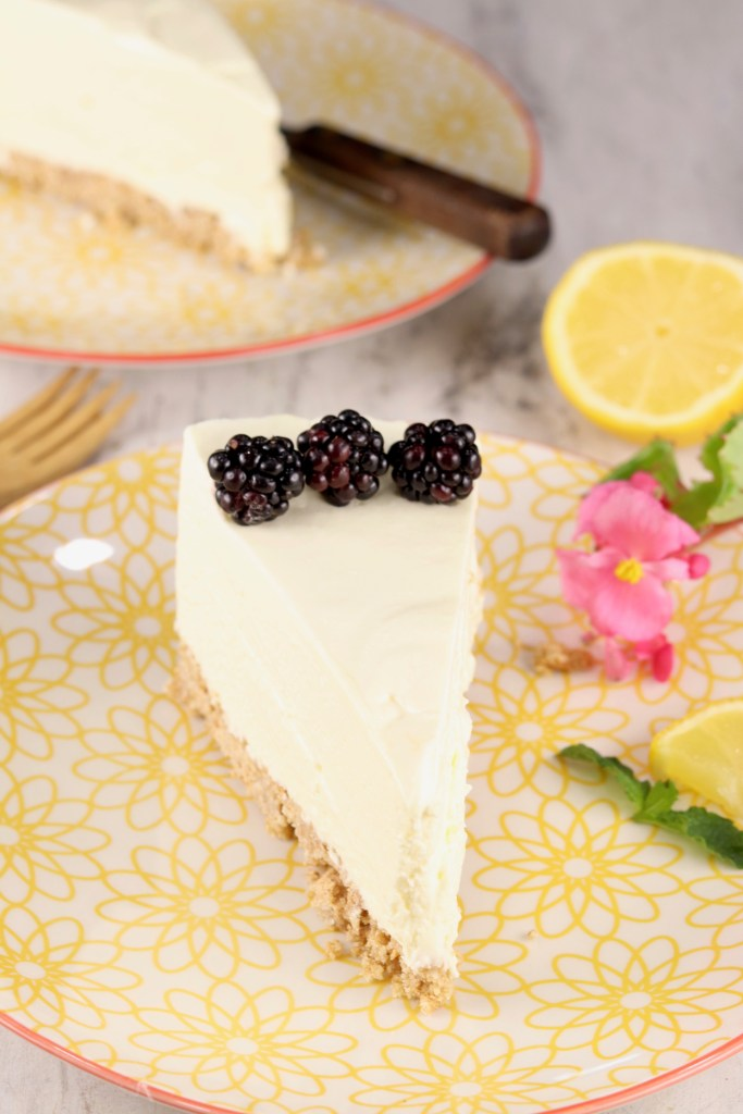 Slice of lemon cheesecake on a yellow plate