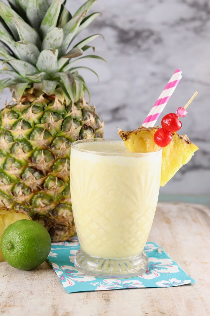 PIna Colada Mocktail with a fresh pineapple to the side