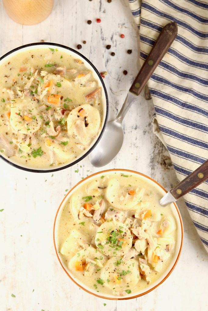 Homemade Dumplings served in bowls with wood handle spoons