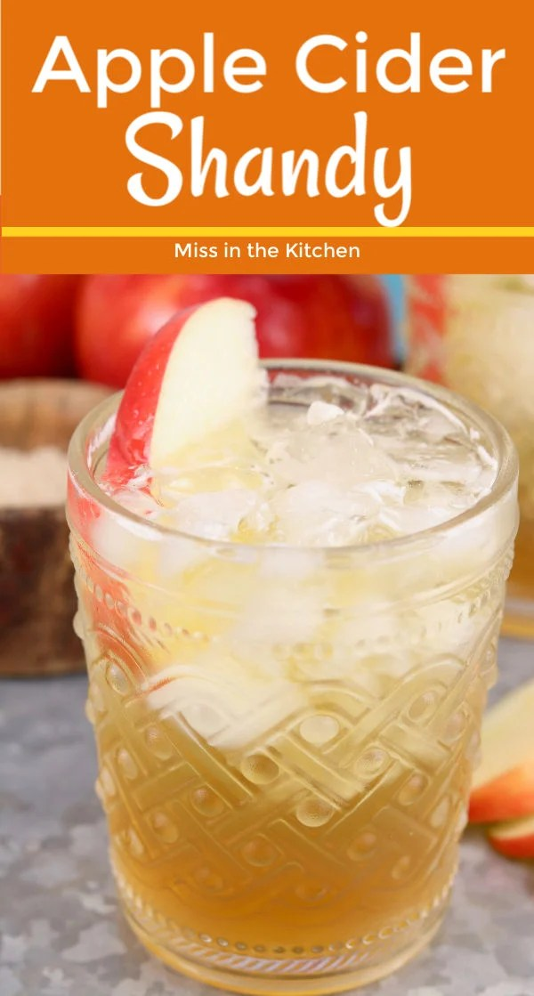 Fall cocktail with apple cider and apple slice garnish
