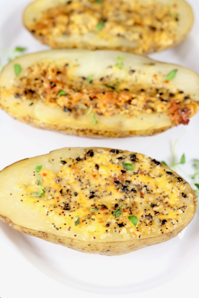 Grilled Potatoes with cheese and seasonings on a white platter