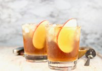 Spiked Apple Cider garnished with fresh apple slices