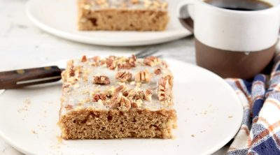 Slices of sheet cake with pecans
