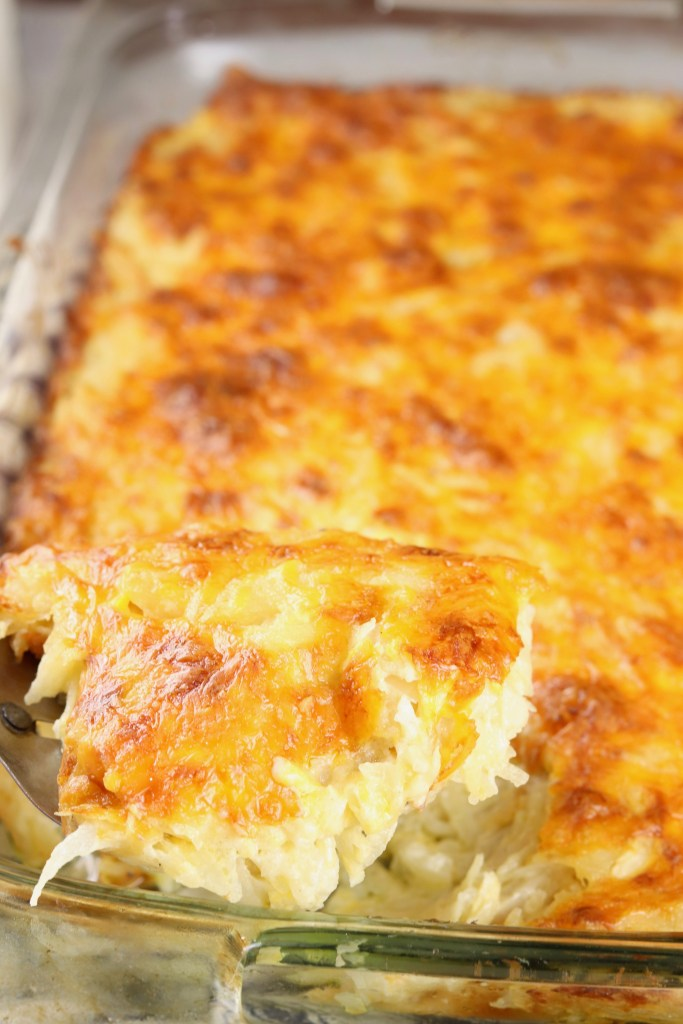 Scoop of hashbrown casserole over dish