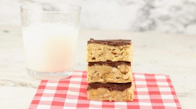 Glass of milk with stack of chocolate peanut butter bars