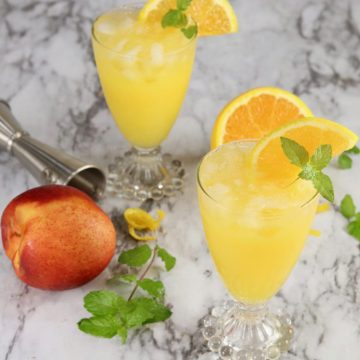 Fresh peach and orange with 2 orange juice cockgtails