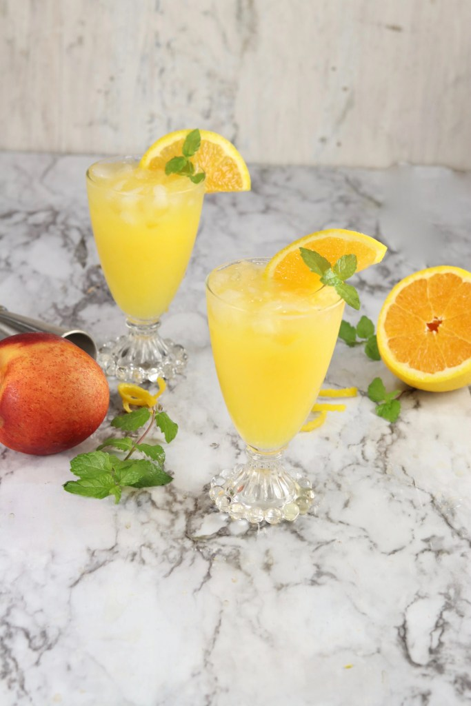Fuzzy Navel with mint and orange garnishFuzzy Navel cocktails are a classic party drink that we just can't get enough of! With just two ingredients, it's one of the easiest drinks you can make for parties!