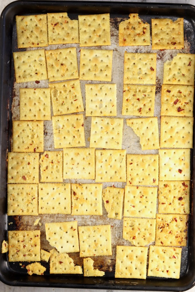 fire cracker saltines on a baking sheet