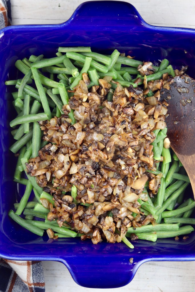 Green beans, mushrooms and onions in a blue casserole dish