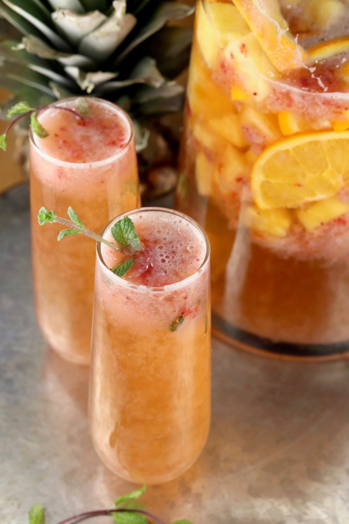 Champagne party punch recipe with fruit and mint