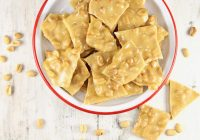 Peanut Brittle in a red rimmed bowl