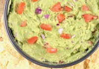 Guacamole dip with tomatoes