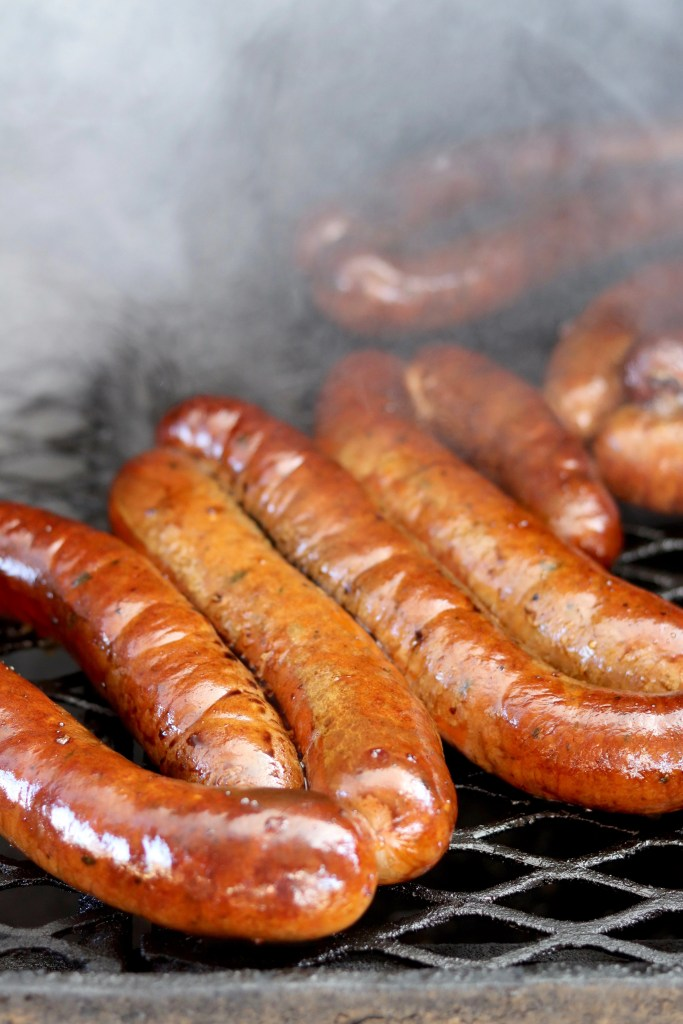 Smoked Andouille Sausages on a grill