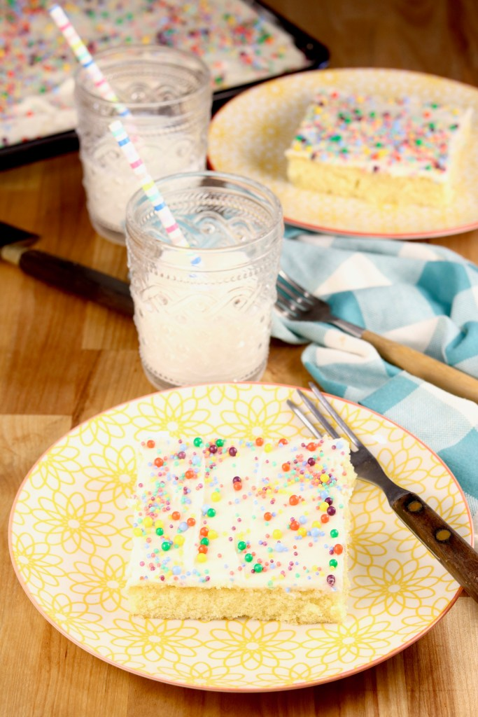Sheet cake with sprinkles and glass of milk