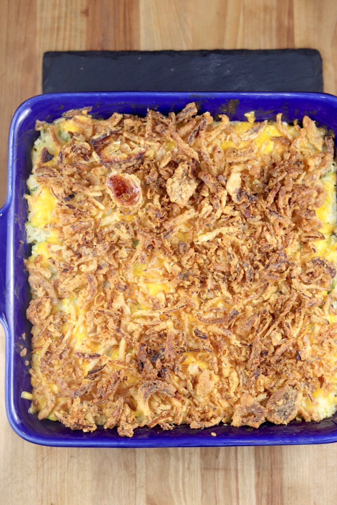 Broccoli Rice Casserole topped with crispy fried onions
