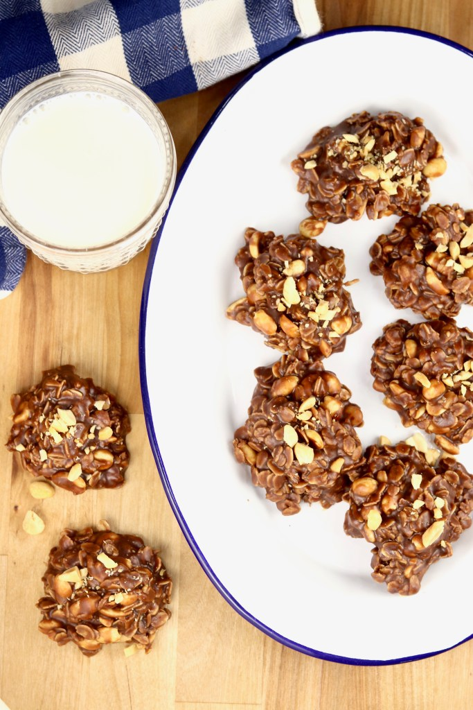 No bake cookies on a tray with a glass of milk